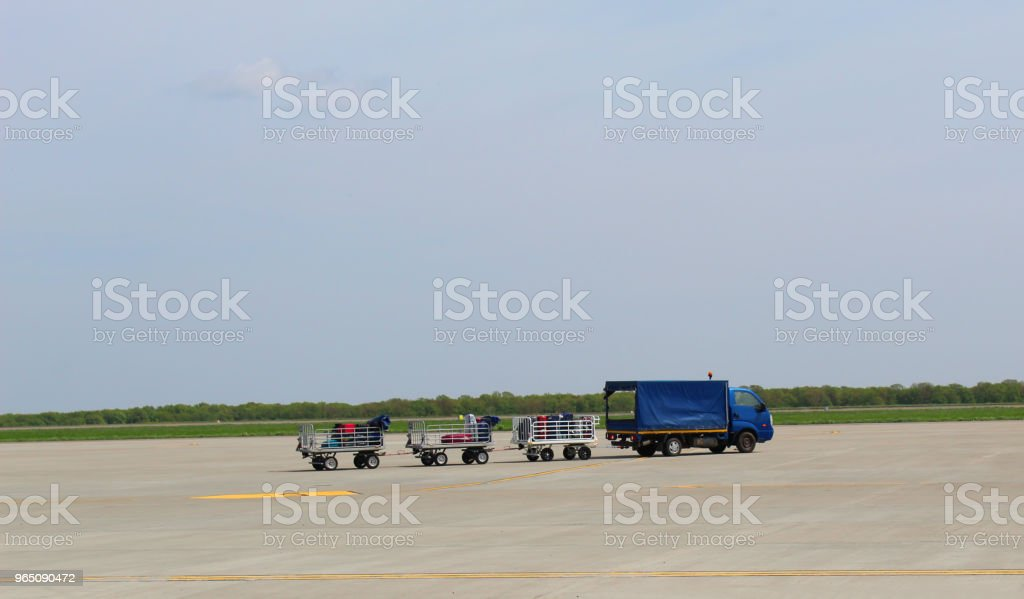 Airport luggage Trolley with suitcases before loading into the aircraft royalty-free stock photo