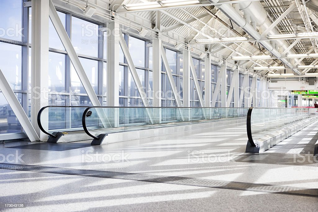 Airport Moving Walkway with Tall Windows, Natural Light, Empty stock photo