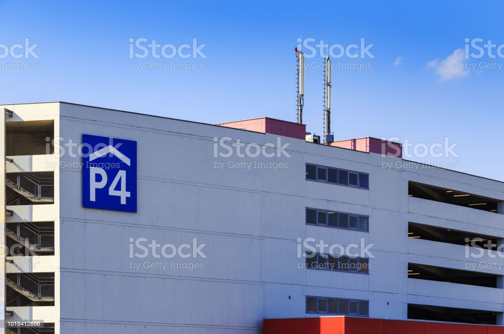 Airport multistorey car park on blue sky background stock photo