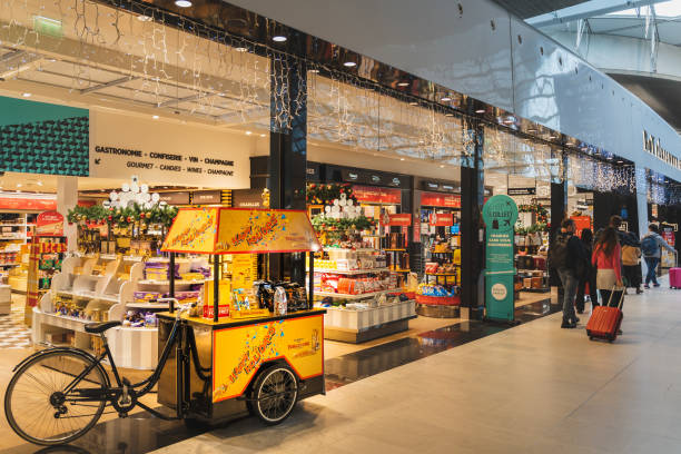 CDG Airport, Paris - 12/22/18: Toblerone promo stand in sweets shop at airport CDG Airport, Paris - 12/22/18: Toblerone promo stand in sweets shop at Paris airport. Yellow vintage bicycle with happy holidays design. val d'oise stock pictures, royalty-free photos & images
