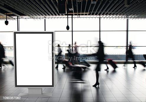 istock Airport passengers crowd walking blurred people billboard advertisement 1090357062