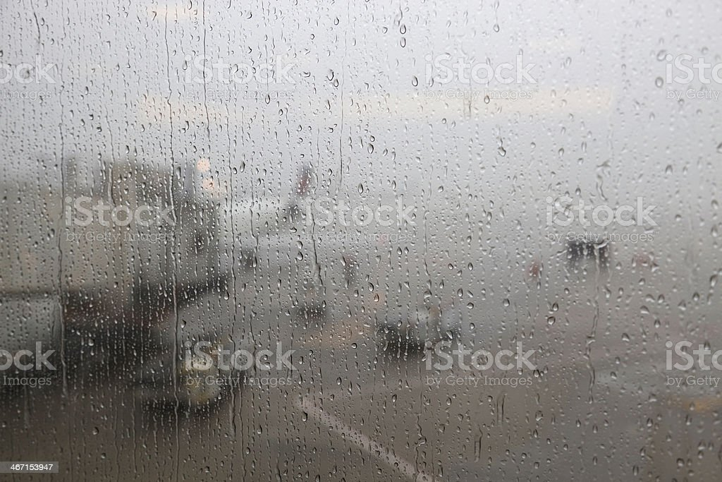 The view of a thunderstorm through the terminal window at an airport...