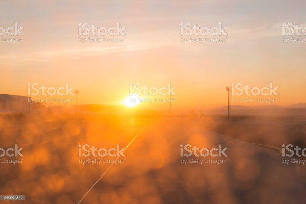 Airport runway at sunrise outdoors stock photo