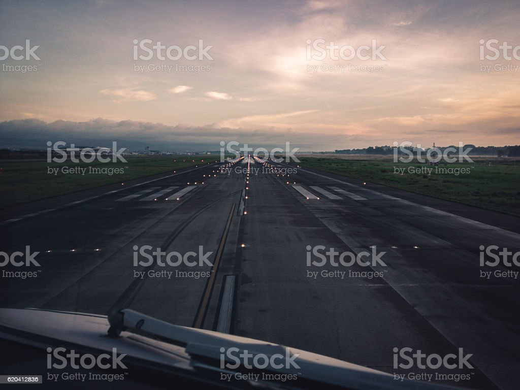 Airport runway at sunrise stock photo