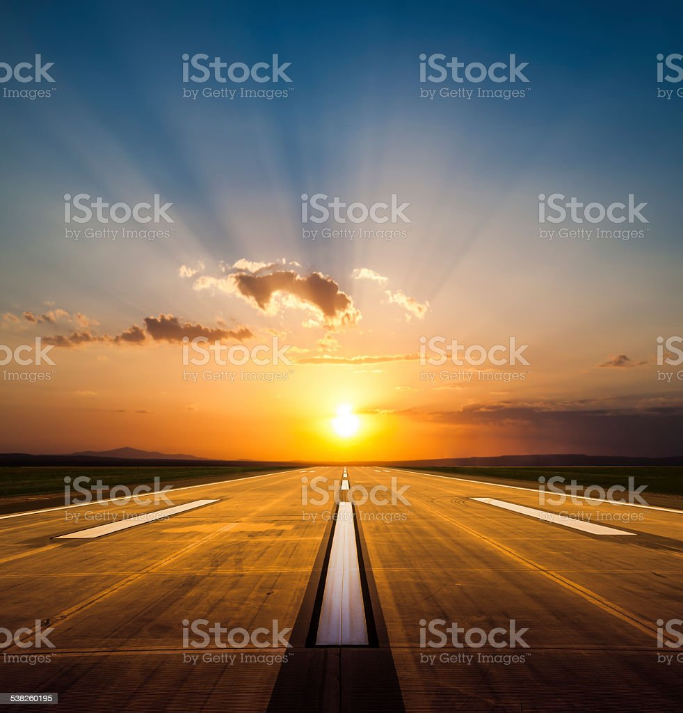 Airport runway at sunset stock photo