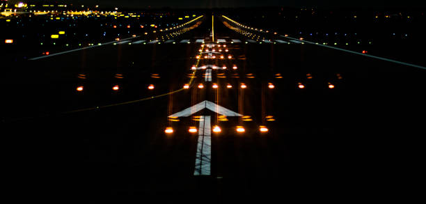 Airport Runway by Night Ready for Take-Off stock photo