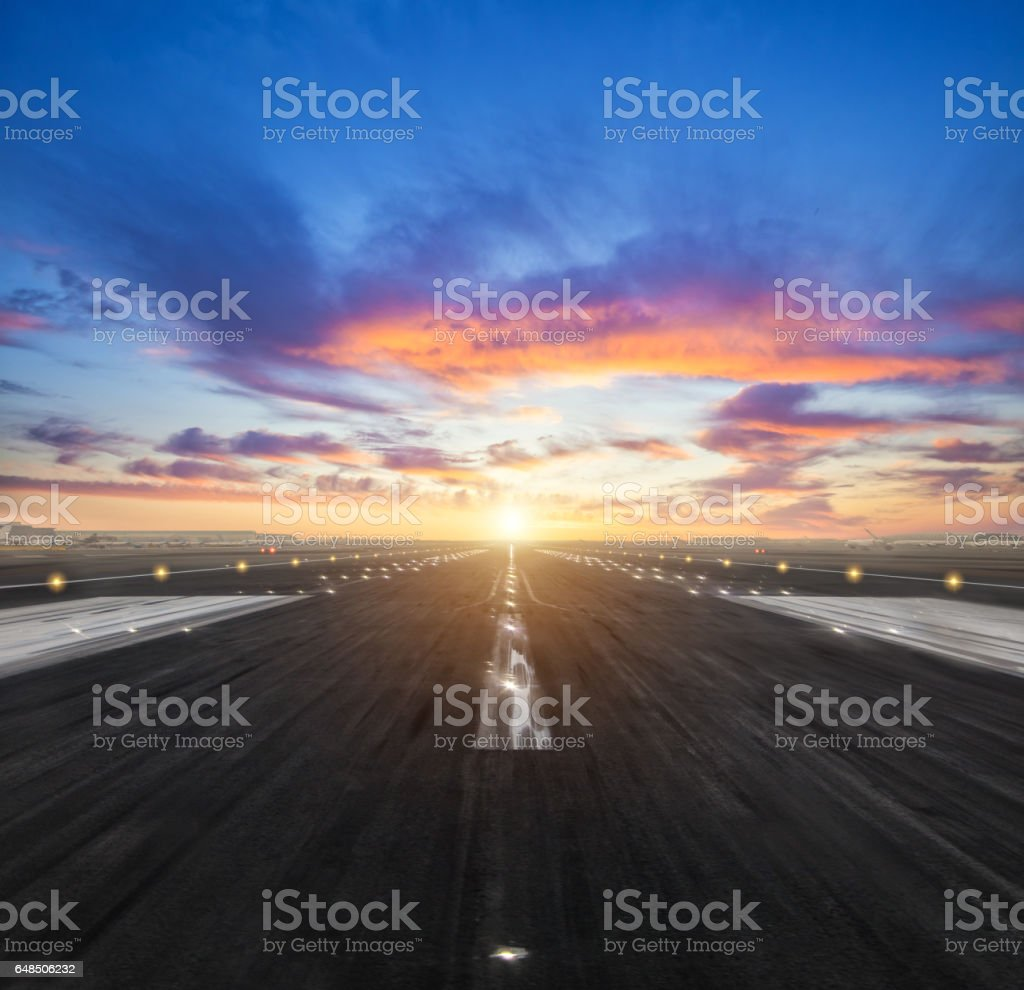 airport runway in the evening sunset light stock photo