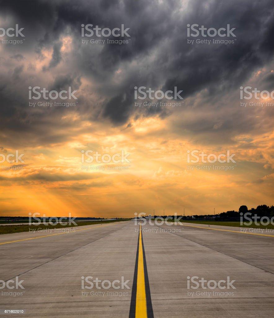 Airport runway on sunset stock photo