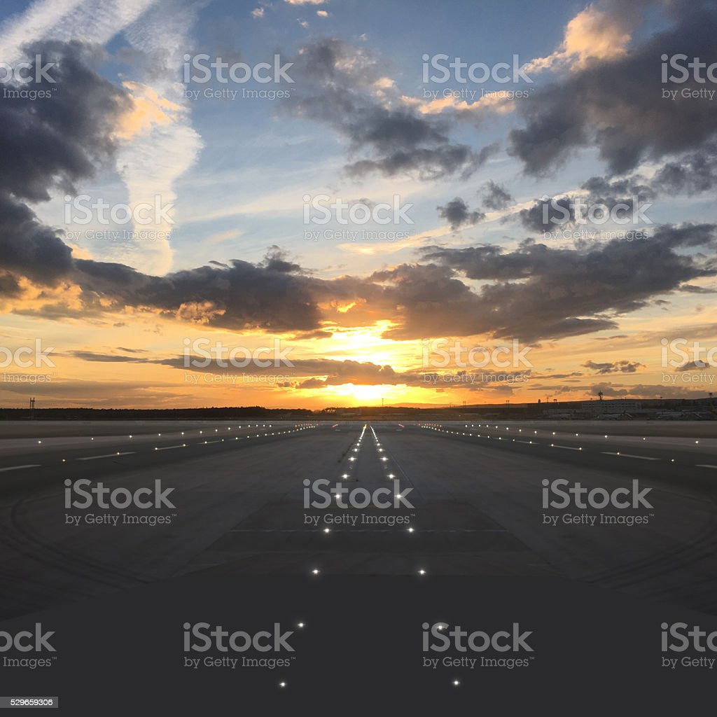 Airport runway takeoff sunset travel stock photo