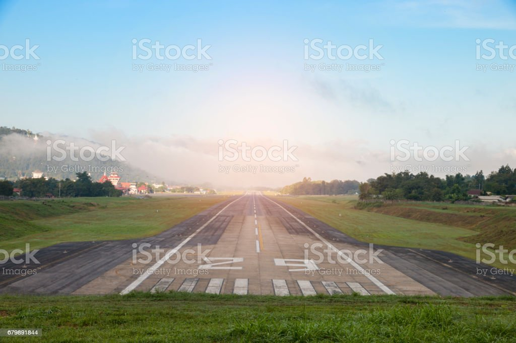 Airport runway with mountain in countryside stock photo