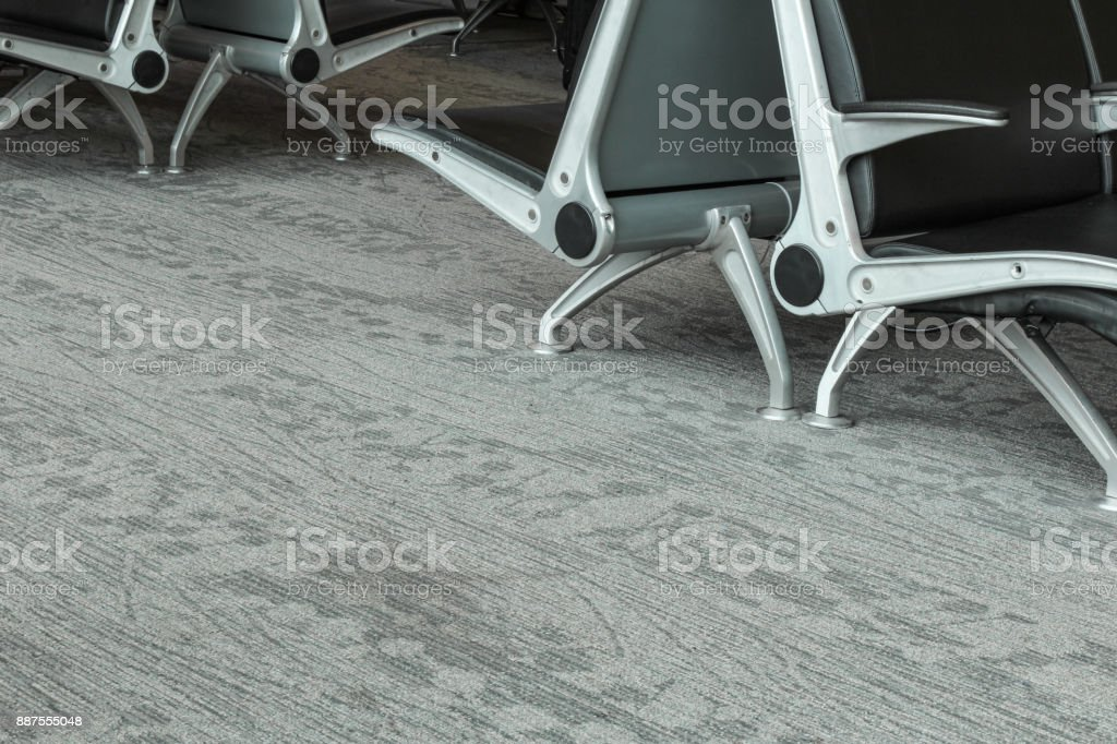 Airport seating metal framed chairs in Boston airport terminal, May 15 2017 stock photo
