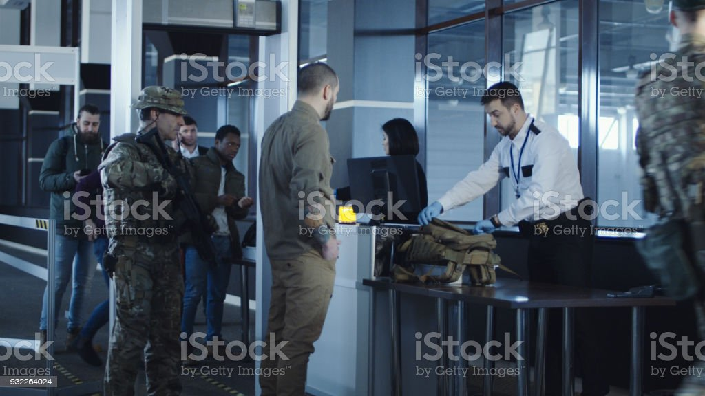 Airport security apprehending a suspect stock photo