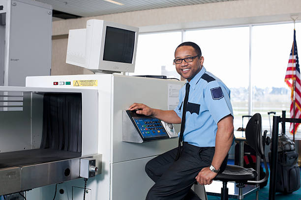 Airport Security Check Point with African American Guard stock photo
