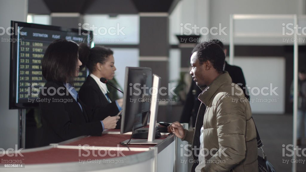 Airport security personnel checking identification stock photo