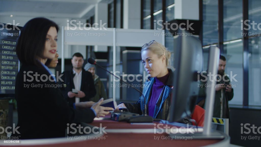 Airport security personnel processing passengers stock photo