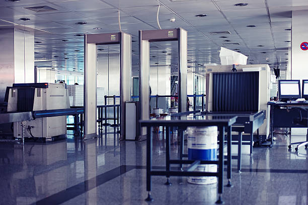 Airport security point with Xray and metal detectors stock photo
