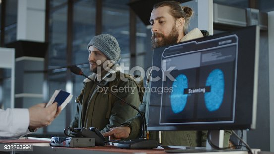 istock Airport security processing a thumb print 932263994