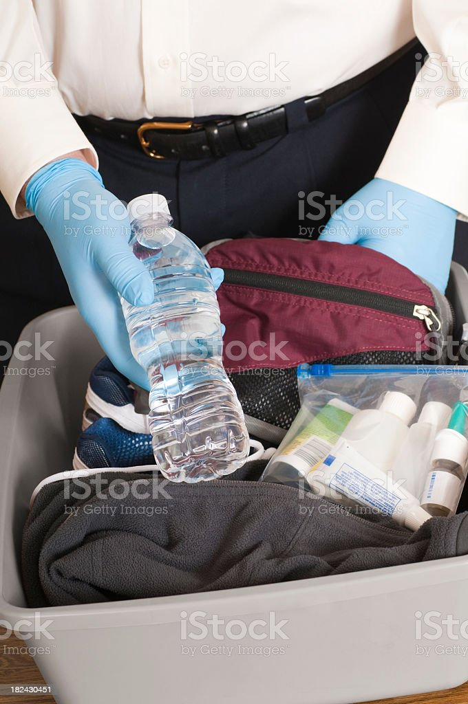 Airport Security TSA Agent Finds a Bottle of Water stock photo