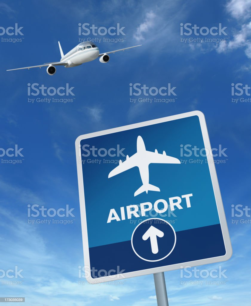 Airport Sign and Flying Airplane royalty-free stock photo