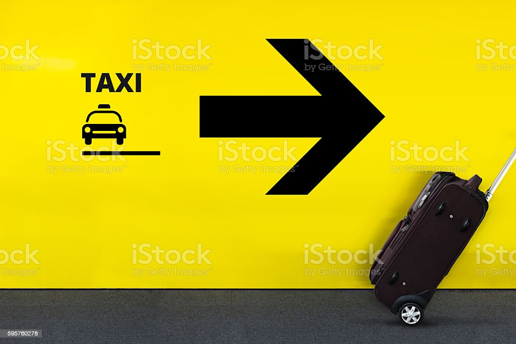 Airport Sign With Taxi Icon, Arrow and moving Luggage stock photo