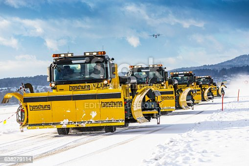Zürich, Switzerland - January 05, 2017: Snow removal at Zurich International Airport. Heavy snowfall caused major delays at many airports in Europe.