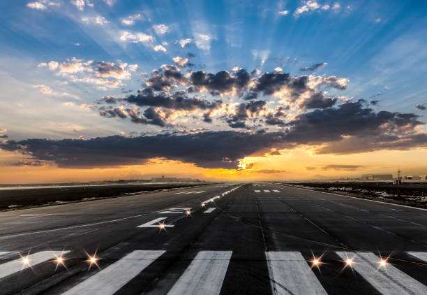 Airport takeoff and landing area at evening Airport takeoff and landing area at evening airfield stock pictures, royalty-free photos & images
