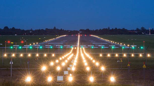 airport takeoff and landing area at evening - vliegveld stockfoto's en -beelden