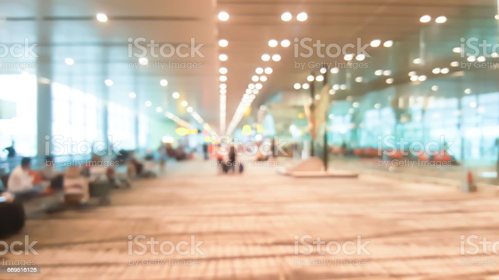 Airport terminal blurred background in international airport stock photo