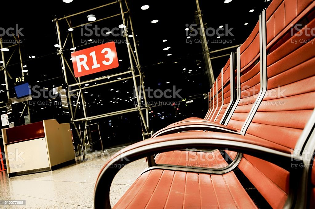 Airport terminal with gate number R13 (bad luck) stock photo