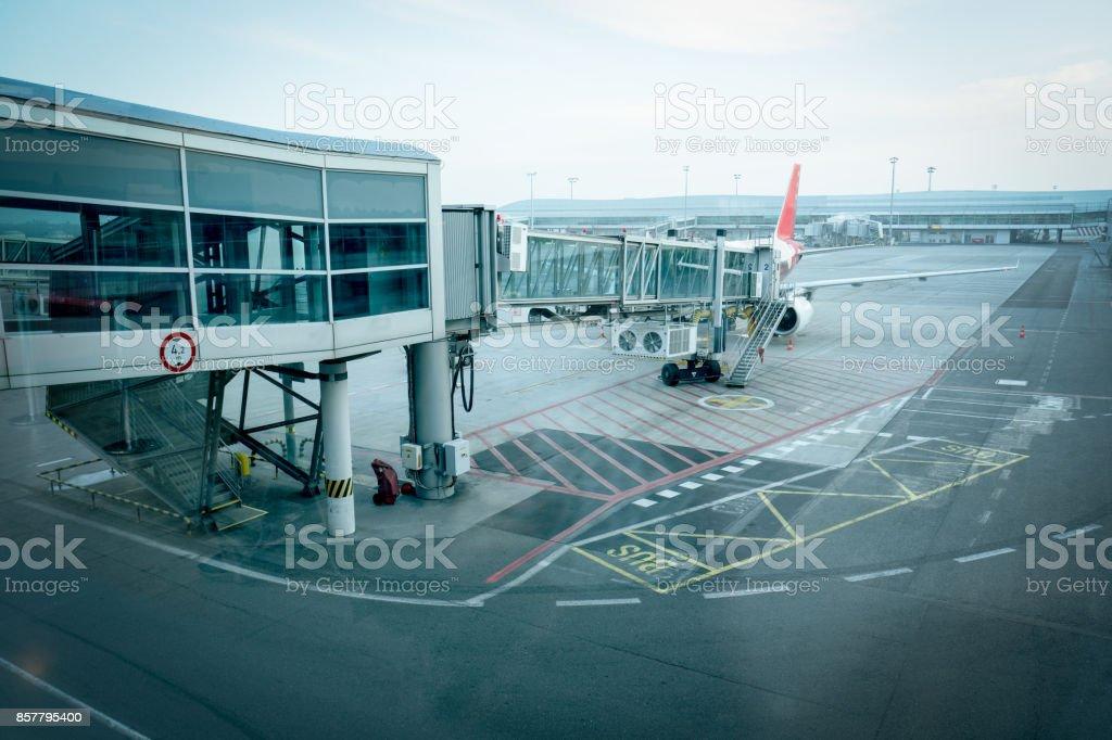 Airport terminal with jet bridge to the aeroplane stock photo