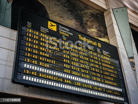 Barcelona, Spain - Jun 4, 2018: Low angle view of Modern electronic Airport departure board with schedule and flights number of diverse international airways destination to Paris, Brussels, Moscow, Malta, Kutaisi, Riga, Bucharest