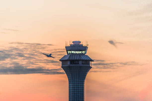 Airport traffic control tower at sunset stock photo