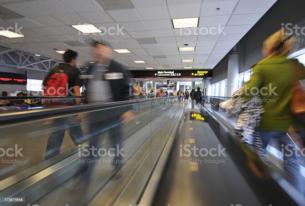 Airport Travelers in Motion stock photo