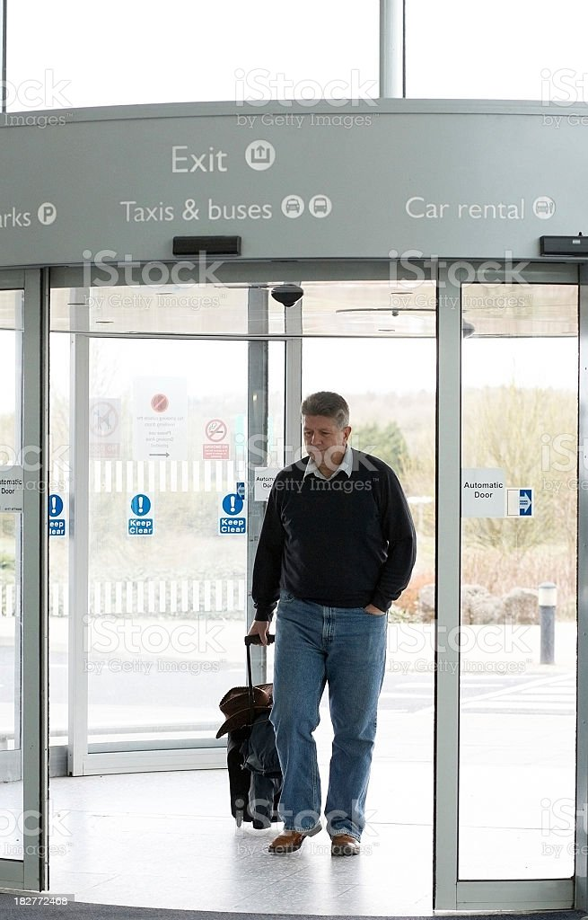 Airport traveller with luggage royalty-free stock photo