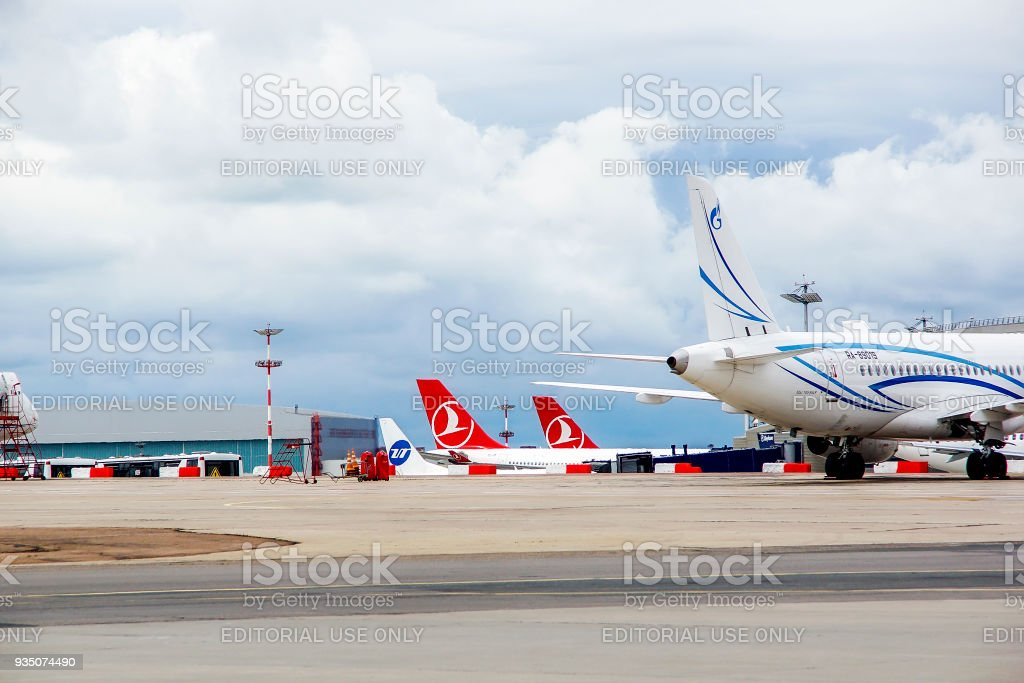 Airport Vnukovo, view of tails part of planes of airline Turkish Airlines, Gazpromavia, Utair. July 2017, Russia Moscow. stock photo
