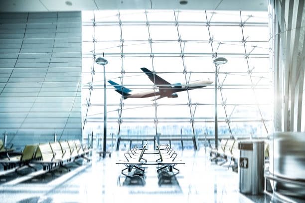 airport waiting lounge and airplane take off and landing - airport stock photos and pictures