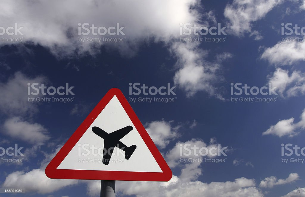 airport warning aircraft sign in blue sky royalty-free stock photo