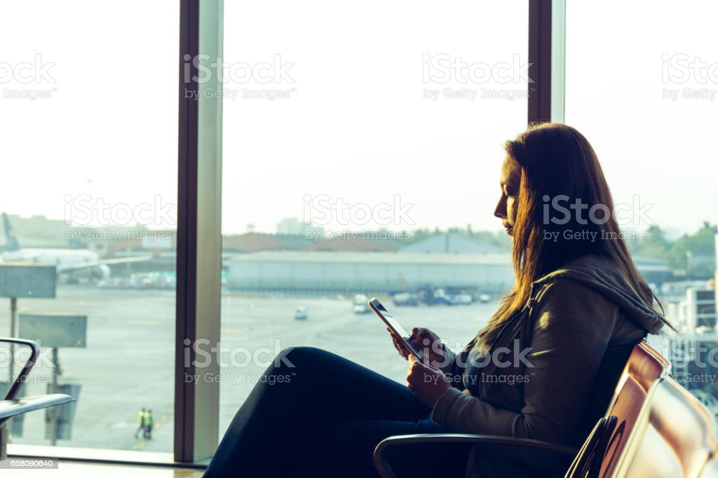 Airport WiFi is such a boon when travelling internationally. royalty-free stock photo