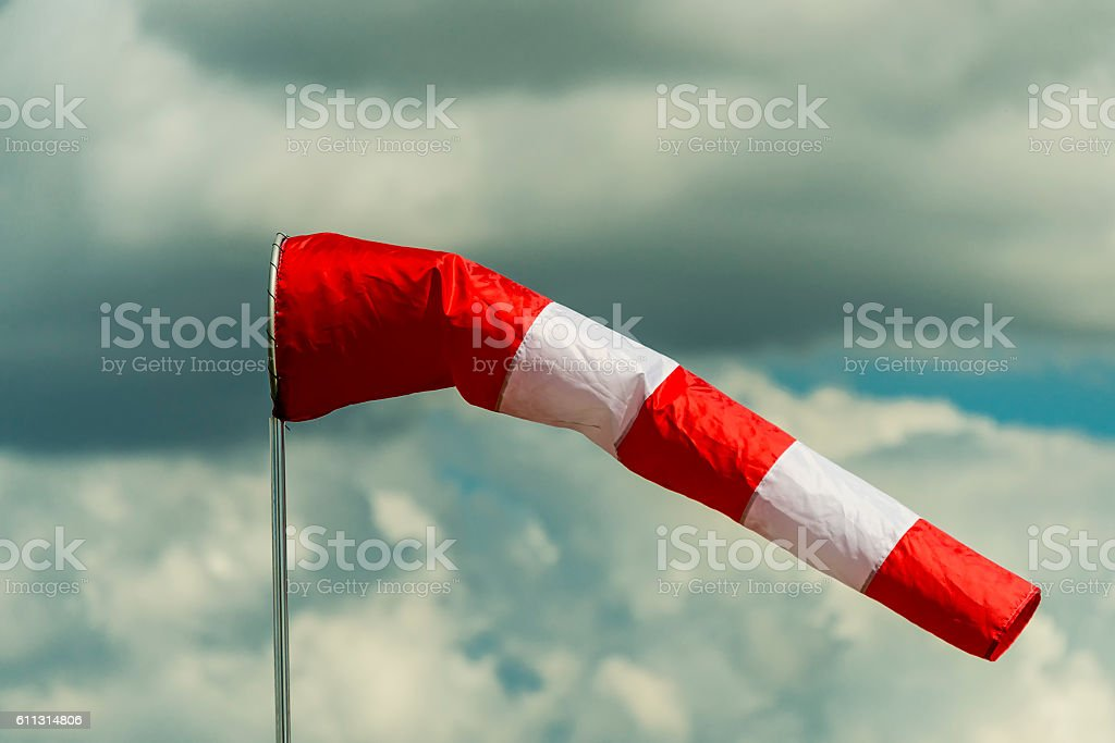 Airport windsock on the background of sky with thunderclouds stock photo