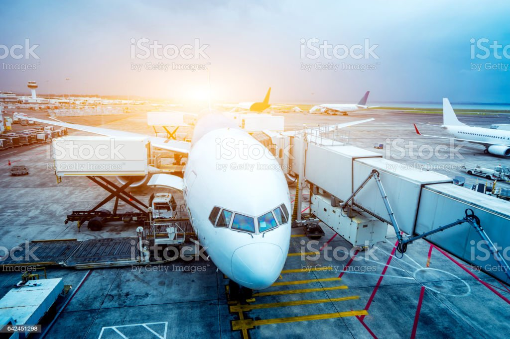 airport with crowded airplanes with sunbeam - foto stock