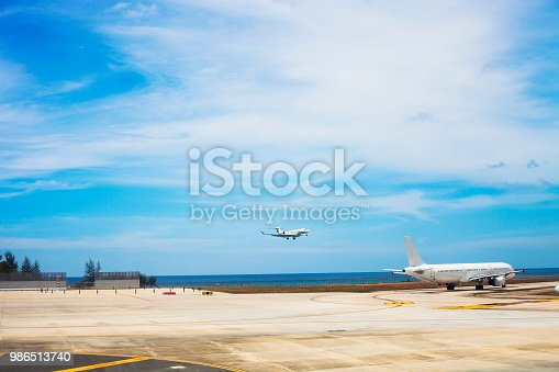 1058205304 istock photo Airport with flying airplane in Phuket, Thailand 986513740