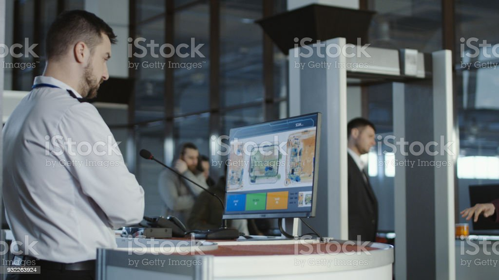 Airport worker exploring x-ray of baggage stock photo