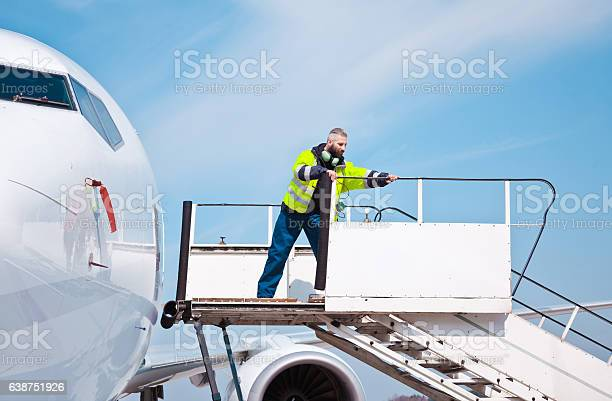 Airport Worker On The Aircraft Stairs Stock Photo - Download Image Now