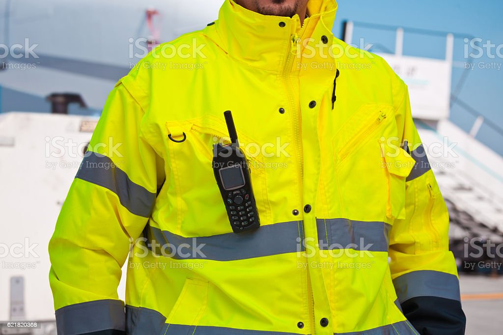 Airport worker outdoor in front of aircraft stock photo