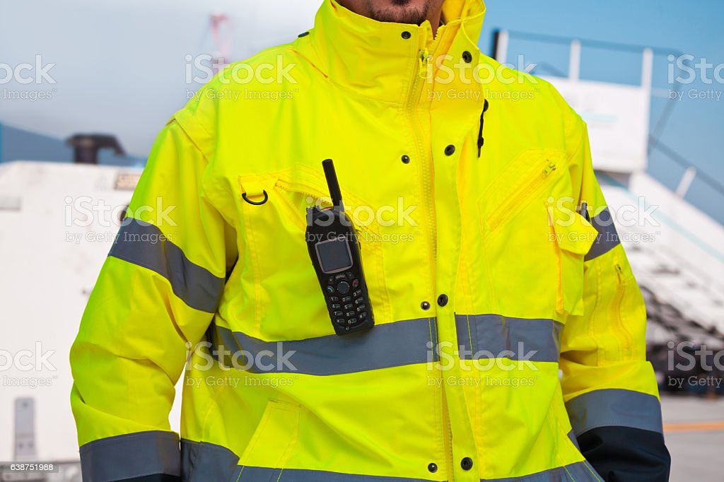 Airport worker outdoor in front of aircraft Airport worker outdoor in front of aircraft at the airport. Part of, unrecognizable person. Adult Stock Photo