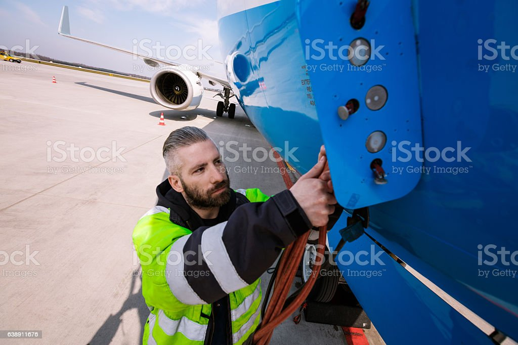 Airport worker Airport worker chcecking aircraft. Adult Stock Photo