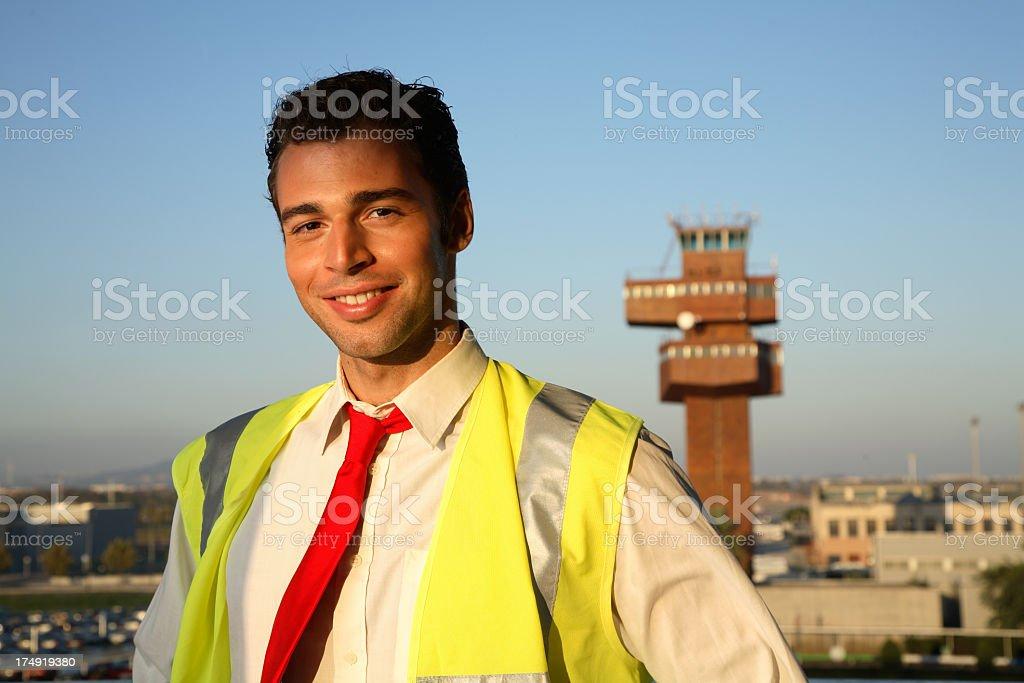 Airport worker wearing neon vest stock photo