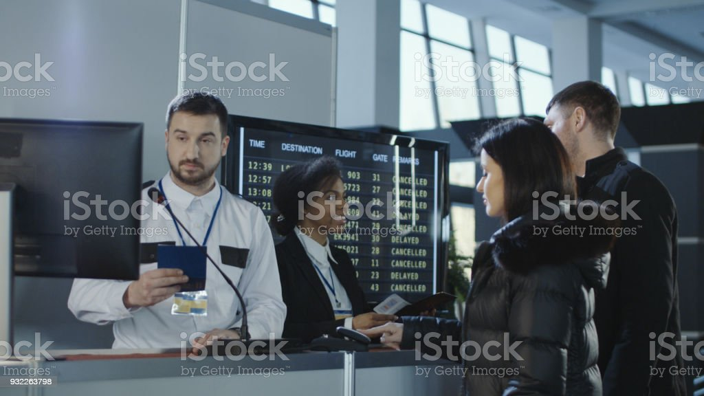 Airport workers checking documents at control point stock photo