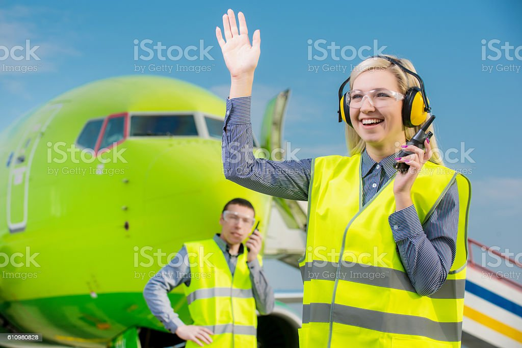 Airport workers with airplane on the background stock photo
