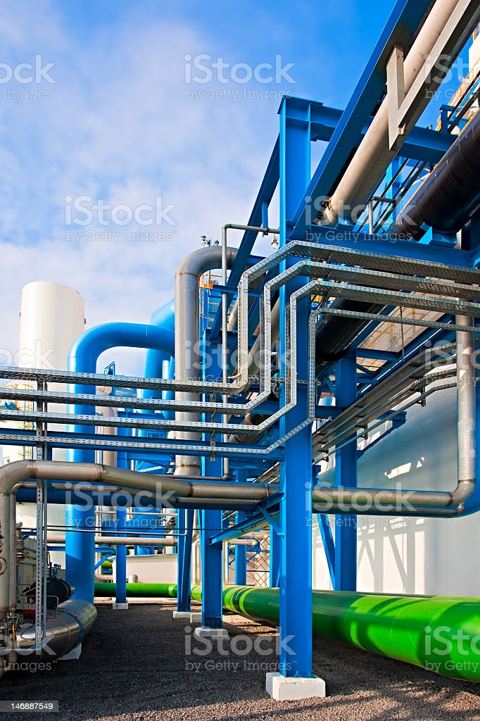 Air-separating factory with blue and green pipes and support stock photo